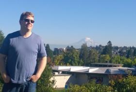 Glenn with Mt, Rainier, a study in blue
