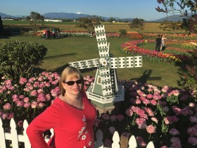 At Roozengarde gardens with windmill and Mt. Baker