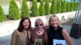 Kelle Grace Gaddis, Natasha K. Moni, and me (holding books!)