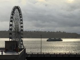 Seattle storm lull with ferris wheel and ferry